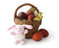 Basket With Easter Eggs And The Rabbit Stock Photos