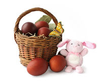 Basket With Easter Eggs And The Rabbit Royalty Free Stock Photo