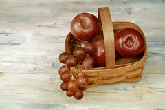 Basket With Red Apples And Grapes Stock Photography