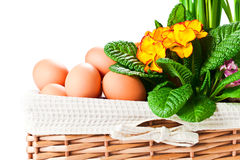 Basket With Spring Flowers And Eggs Royalty Free Stock Images