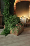 Basket with wood fireplace Stock Photography