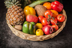 Basket of wood in the table of most fresh fruits and vegetables Royalty Free Stock Photos