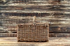 Basket on wooden background stock photos
