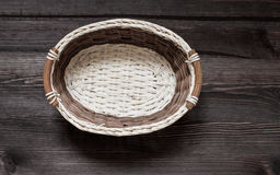 Basket on wooden background. Royalty Free Stock Image