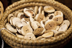 Basket of wooden buttons Stock Photos