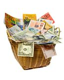 Basket of world currencies. Basket full of currency notes of various countries Royalty Free Stock Images