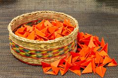Basket of woven straw with red paper royalty free stock photo