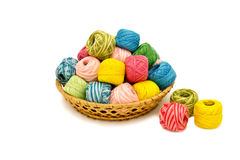 Basket with yarn. Basket with bright multi-colored yarn for needlework Royalty Free Stock Photography