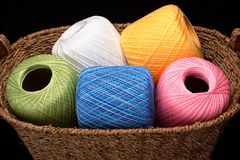 Basket of Yarn (wide view). A woven basket filled with colorful spools of yarn stock photography