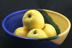 Basket of yellow apples Stock Photography