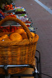 A basket with yellow Dutch cheese. On a street market in Amsterdam, this basket of Dutch cheese was inviting tourists to walk into the shop and look at the Stock Image