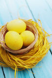 Basket with yellow eggs Stock Image