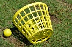 Basket of yellow golf balls Royalty Free Stock Photography