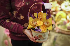 Basket with yellow orchid flowers. Stock Image