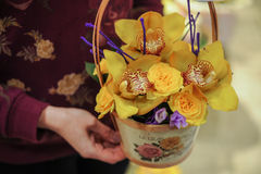 Basket with yellow orchid flowers. Royalty Free Stock Photography