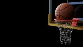 Basketbal die in hoepel op zwarte geïsoleerde achtergrond gaan Sport a Royalty-vrije Stock Foto