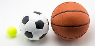 Basketbal en van de voetbalbal tennisbal royalty-vrije stock foto's