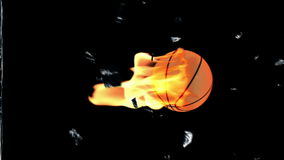 Basketbal on fire breaking glass with Alpha, stock footage
