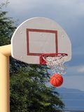Basketball. A basketball swishes through the net Stock Image