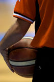 Basketball. Referee holds basketball during a time out Royalty Free Stock Photo