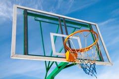 Basketball. Hoop in the park against the blue sky Stock Photos