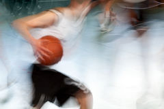 Basketball. A man during a basketball game carrying a basketball