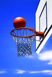 Basketball. Photo of basketball hoop and blue sky in background stock images