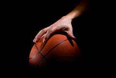 Basketball. Player plays with a basketball Stock Photos