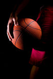 Basketball. Player Holds a Basketball at his leg Royalty Free Stock Photos