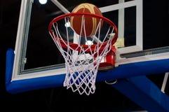 Basketball. Success. Ball going through the net Stock Images