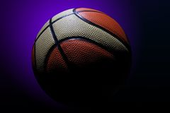 Basketball. With nice illumination and purple background royalty free stock image