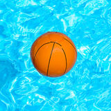 Basketball. Ball of basketball in a pool Royalty Free Stock Photography