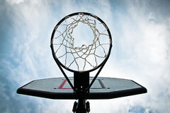 Basketball. Street basketball with clouds background Royalty Free Stock Image