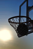 Basketball. Silhouette of a basketball going through the hoop Stock Photo