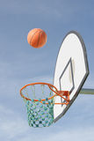 Basketball. Flying into the hoop Stock Images