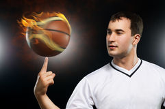 Basketball. Man spinning basketball on finger Royalty Free Stock Photography