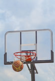Basketball. A basketball swishes through the hoop- streetball match detail Stock Images