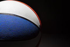 Basketball. Multicoloured Basketball shot on a black background with Rim lighting royalty free stock images