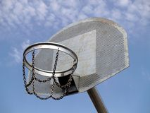 Basketball. Metallic basketball board and hoop with blue sky in the background Stock Photos
