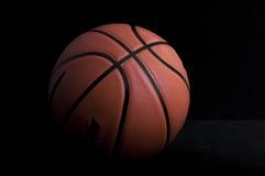 Basketball. Basket ball on dark background Stock Photos