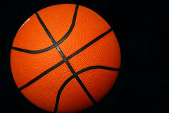 Basketball. An isolated photo of a basketball in a black background Royalty Free Stock Images