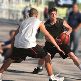 Basketball. Young men playing basketball outdoor Stock Photo