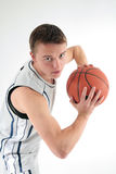 Basketball. Young man portrait with basketball ball Royalty Free Stock Images