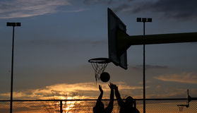 Basketball. Silhouettes of basketball players at the sunset Royalty Free Stock Photography