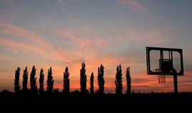 Basketball. 10 players and judges. Sunset and wonderful evening Stock Photography