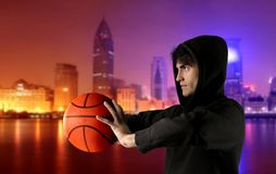 Basketball. A basketball player and a cityscape Royalty Free Stock Image
