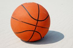 Basketball. A basketball on a sandy beach during hot, sunny day. The ball took part in lots of the games Royalty Free Stock Photos