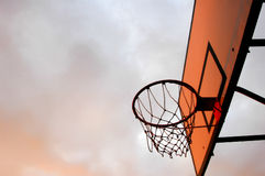Basketball. A bouquet of evening sunlight in the basketball board stock photos