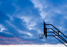 Basketball. A bouquet of evening sunlight in the basketball board royalty free stock photography