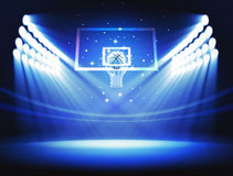Basketball arena. Hoop and ball in the basketball arena with spotlights Stock Photos
